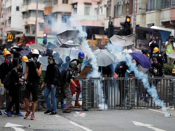 Police fired tear gas at the black-clad protestors who had occupied the main thoroughfare of Cheung Sha Wan Road in Sham Shui Po district on Sunday.