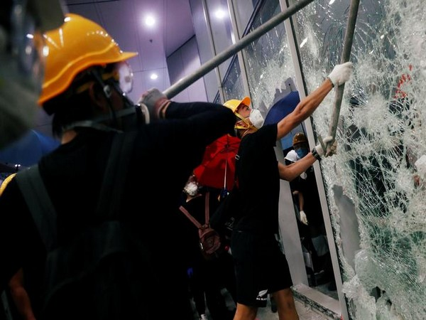 Hong Kong Protesters removed metal fencing and smashed glass doors at the Legislative Council building on Monday evening.