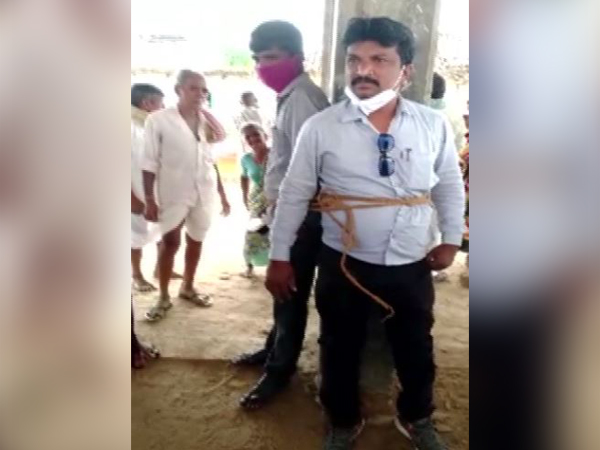 Two electricity department officials tied with a rope in Medak