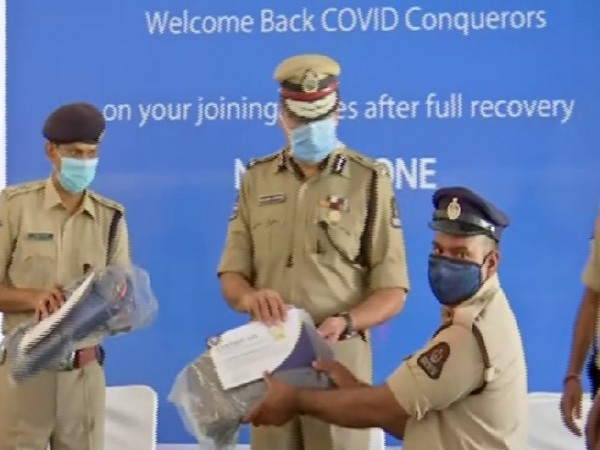 Anjani Kumar, Commissioner of Police, Hyderabad City with police personnel joining back duty on Thursday.