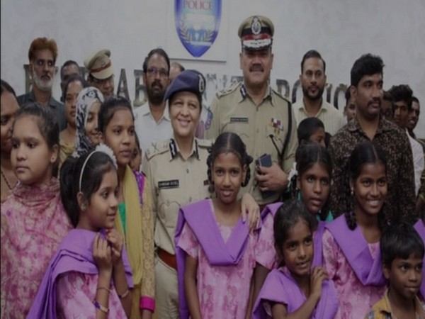 Hyderabad police officials with some of rescued children