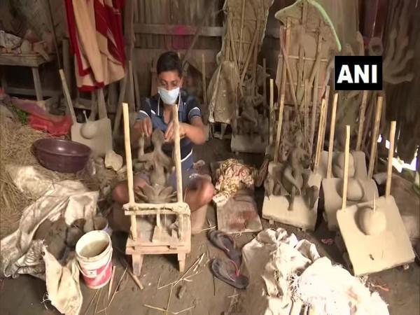 An idol maker making idols in Assam's Guwahati (Photo/ANI)