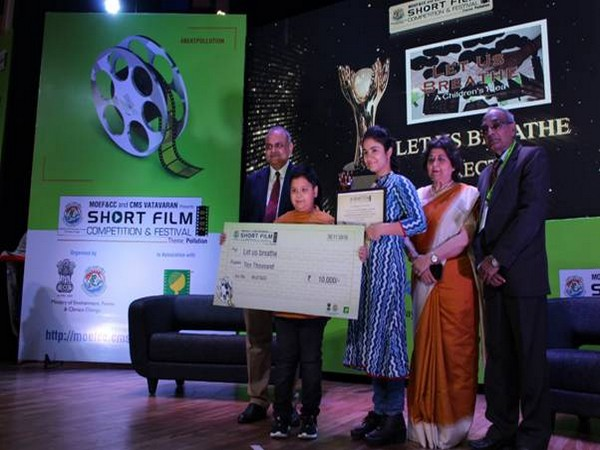 School student receiving the award for his film at 2019 CMS VATAVARAN film festival
