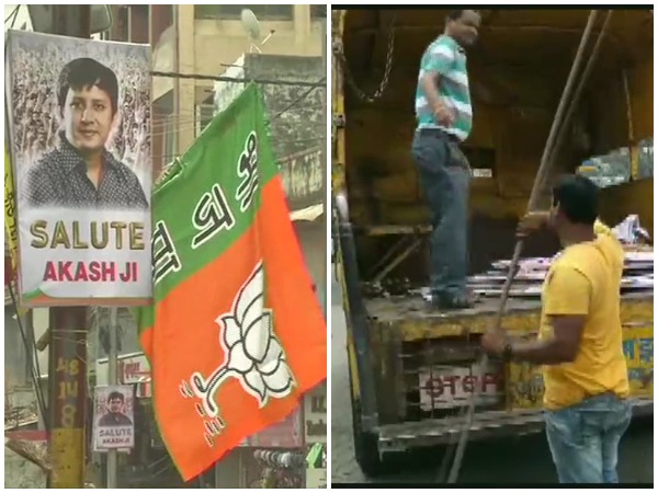 Indore Municipality workers while removing the posters put up in favour of BJP MLA Akash  Vijayvargiya on Friday. (Photo: ANI)