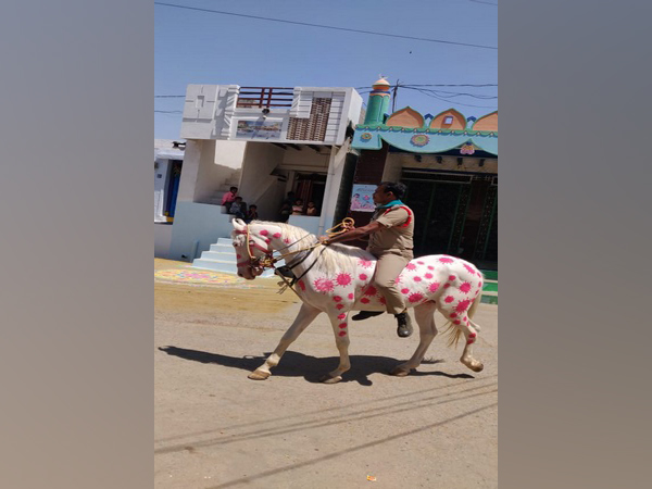 A poliman riding a horse in Kurnool with COVID-19 design. [Photo/ANI]