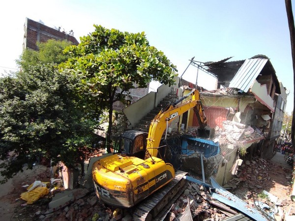 A visual of the demolition of illegal house in Indore.