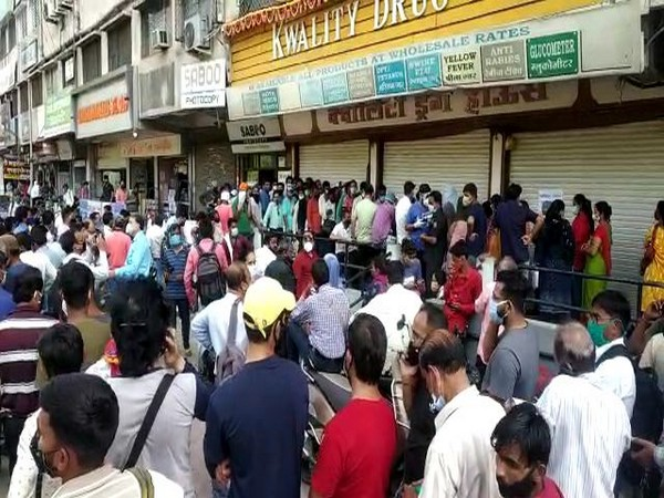 A visual of the people outside the medical store in Indore. Photo/ANI