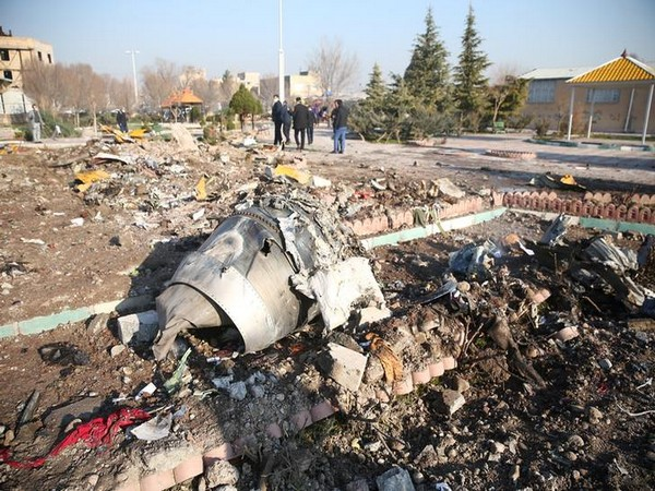 Debris of a Ukrainian Boeing 737 aircraft that crashed after taking off from Iran's Imam Khomeini airport on Wednesday