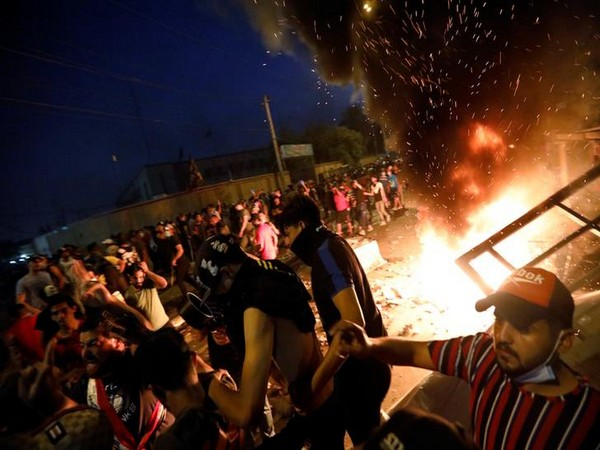 Demonstrators gathered at a protest site during a curfew in Baghdad on Thursday.