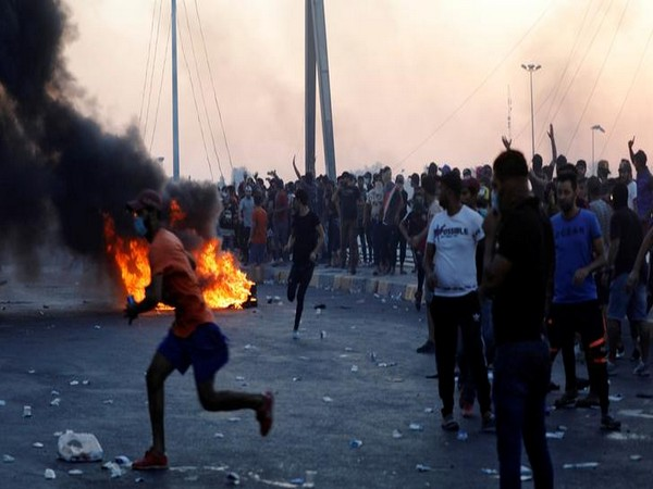 Demonstrators gathered at a protest site in capital Baghdad following the lifting of the curfew on Saturday.