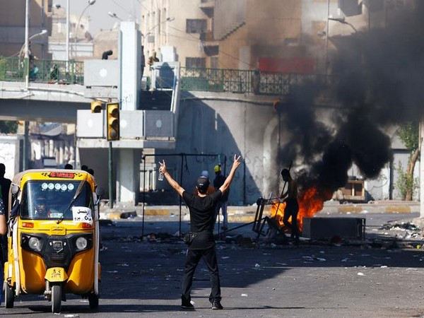 A demonstrator gestures during the ongoing anti-government protests in Baghdad on Saturday