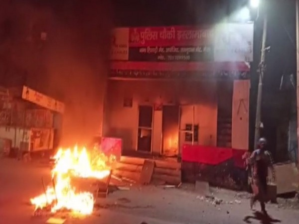 A policeman at a police post which was set on fire by protesters in Meerut on Friday. Photo/ANI
