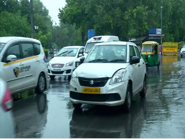 Traffic jam at RK Puram due to rain. Photo/ANI]