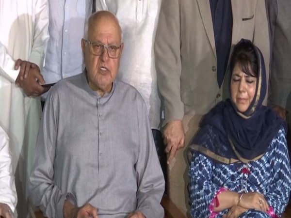 National Conference chief Farooq Abdullah and PDP president Mehbooba Mufti in Srinagar on Sunday. Photo/ANI