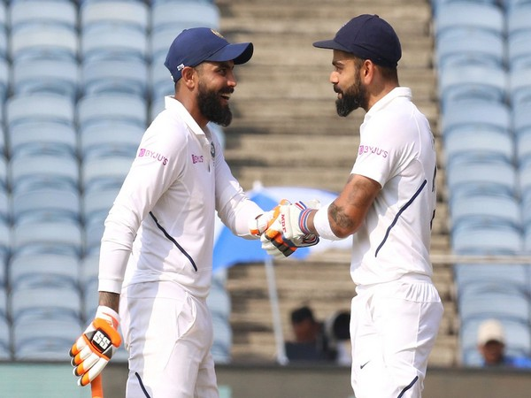Ravindra Jadeja (L) and Virat Kohli (R) during their partnership on day two of Test in Pune on Friday. (Photo/BCCI Twitter)