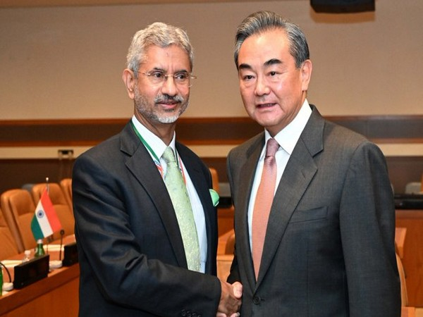 External Affairs Minister S Jaishankar with Chinese FM Wang Yi in New York on Wednesday