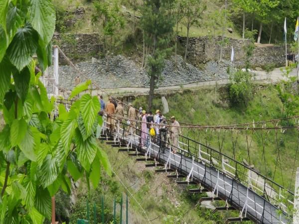 Bandipura youth repatriated from PoK at Tithwal Bridge in J-K's Karnah on Monday. (Photo/ANI)