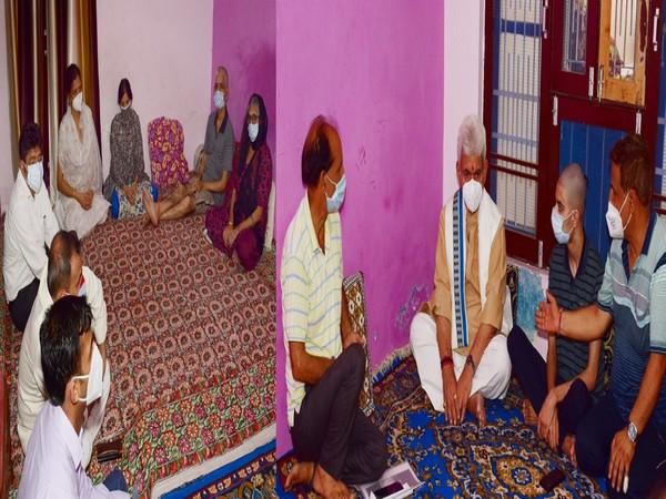 Lt Governor Manoj Sinha visits Municipal Councillor Rakesh Pandita family. (Photo/ ANI)