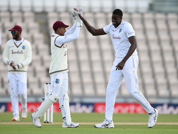 West Indies' Jason Holder celebrates the wicket of England's Ben Stokes with teammates
