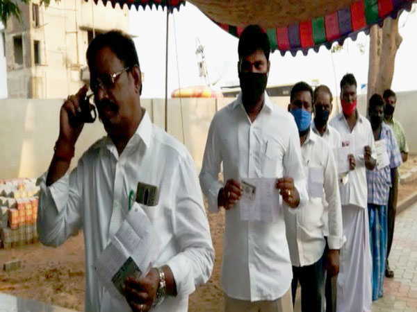 People queue up to vote in Andhra Pradesh. (Photo/ANI)