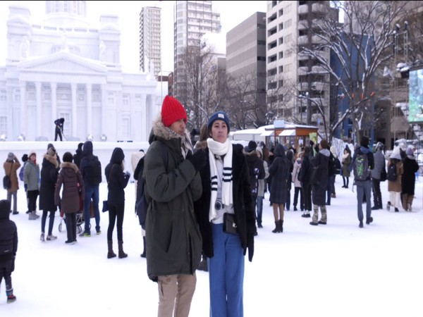 Tourists enjoying snow during Sapporo Snow Festival in Japan