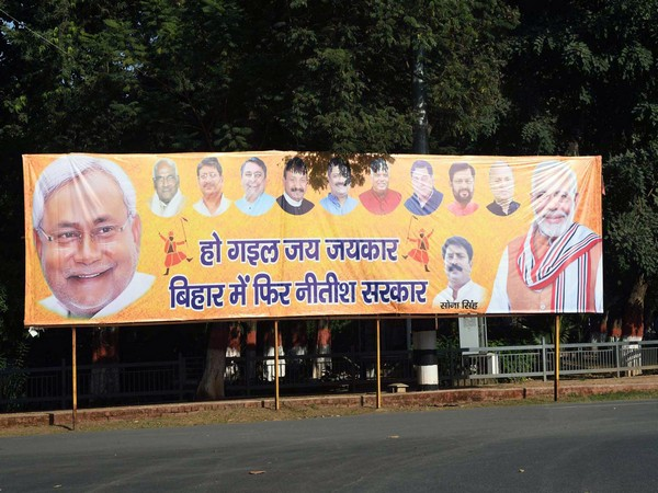 NDA's supporters put up a hoarding in Patna after the declaration of the Bihar Assembly elections results. (ANI Photo)