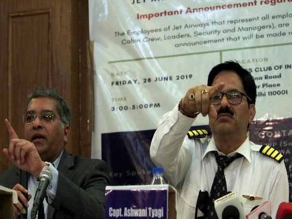 AdiGroup founder Sanjay Viswanathan, left, along with Jet Airways employee A Tyagi addressing a press conference in New Delhi on June 28. Photo/ANI