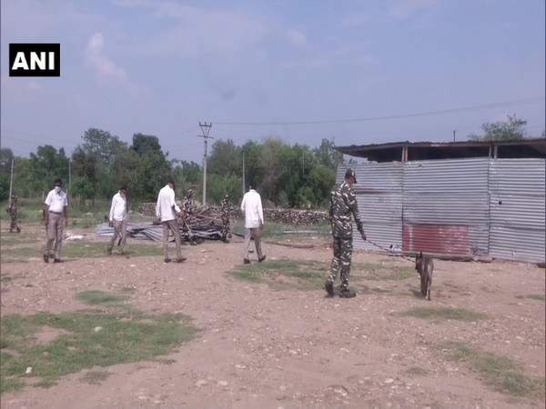 CRPF using metal detectors to search the ares