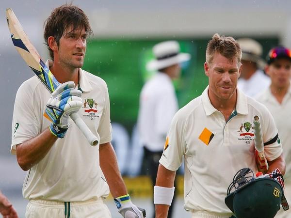 Australian cricketers Joe Burns (left) and David Warner