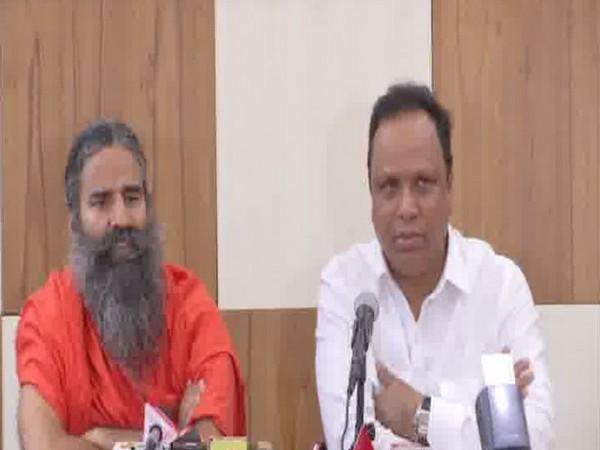 Yoga Guru Ramdev and Maharashtra Education Minister Ashish Shelar speaking at a press conference in Mumbai on Wednesday. Photo/ANI