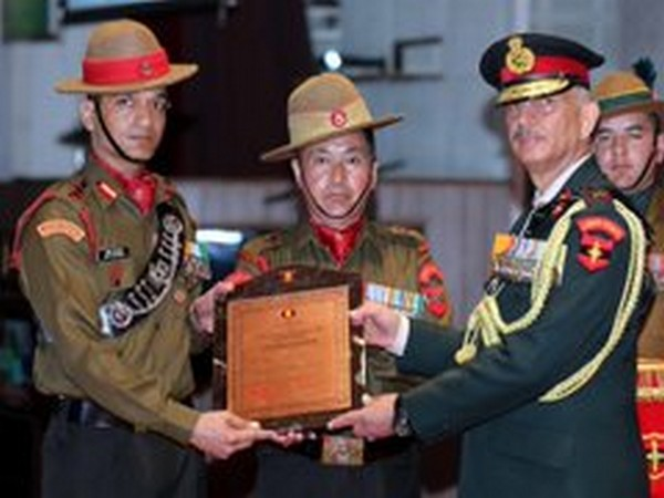 Lt Gen YK Joshi presents award to a soldier at Udhampur on Thursday. Photo/ANI