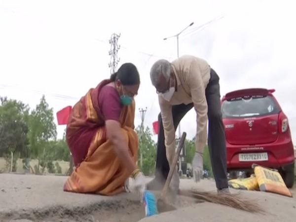 Old couple filling potholes on roads of Hyderabad (Photo/ANI)