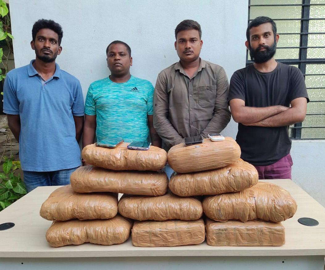 Four accused with seized drug in Hyderabad.