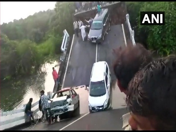 The bridge broke apart from the middle when vehicle were passing through it on Sunday. Photo/ANI