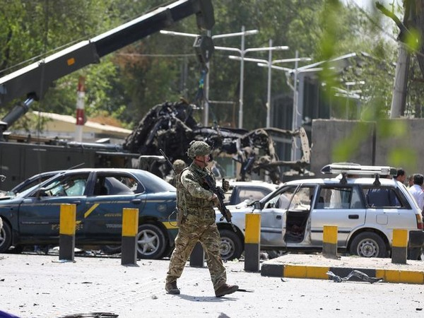 A soldier inspects the site where the car bombing occurred in Kabul on Thursday