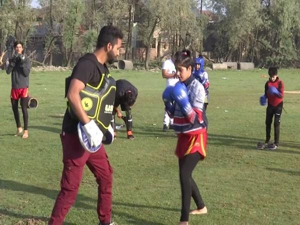 Wushu coach Rameez Ahmad training students