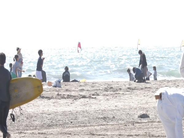 People enjoying at Kamakura Beach in Japan