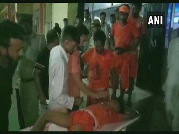 An injured Kanwariya being shifted to hospital. (Photo/ANI)