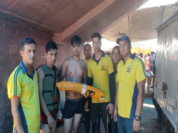 An SDRF official saved a kanwariya from drowning in Kangra Ghat in Haridwar using the life tube procured from Germany . Photo/ANI