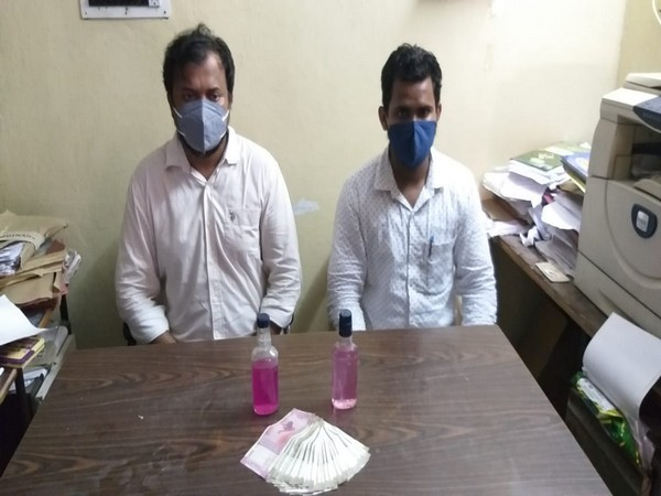 A photo of the two arrested officials in Karimnagar, Telangana.