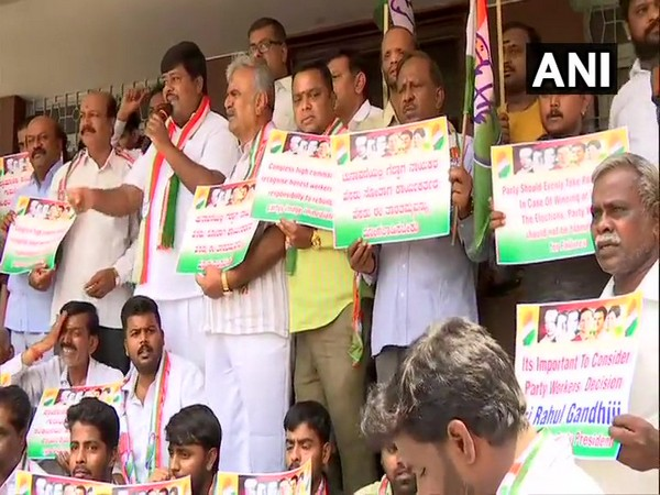 Visuals of Congress party workers' demonstration outside party office in Karnataka. Photo: ANI.
