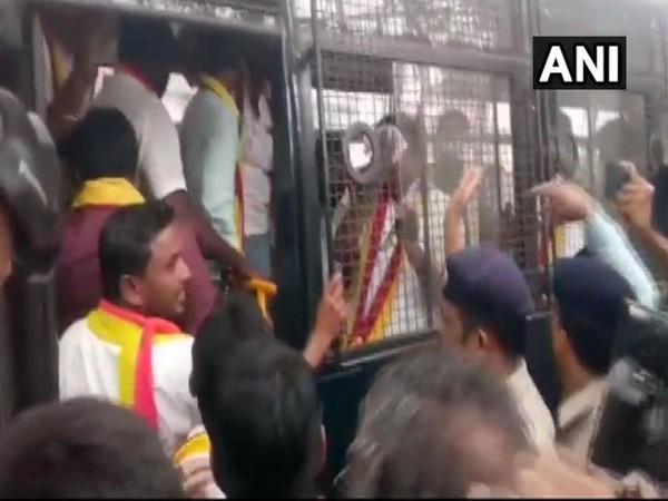 Karnataka Rakshan Vedike members being detained by police in Belagavi on Wednesday. (Photo/ANI)