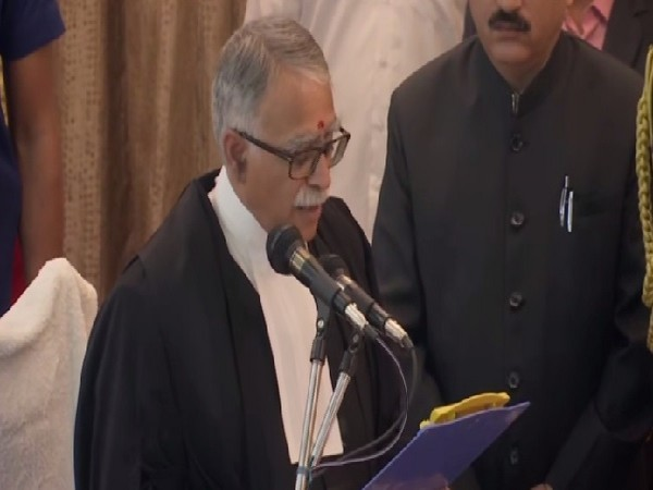 Justice Sanjay Karol taking oath as Chief Justice of Patna High Court at on Monday.