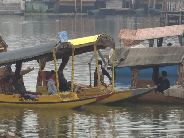 The tourists were seen enjoying a traditional shikara ride in the Dal Lake, Srinagar. (Photo/ANI)