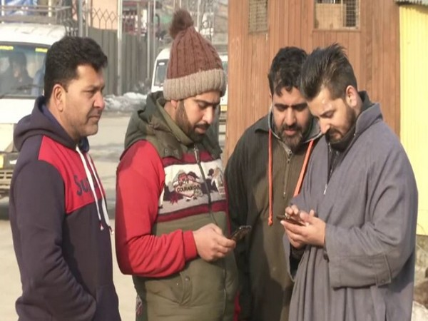 Youth in Jammu city using mobiole internet services on Saturday morning [Photo/ANI]