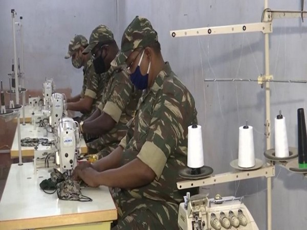 CRPF personnel make face masks amid the COVID-19 pandemic. (Photo/ANI)