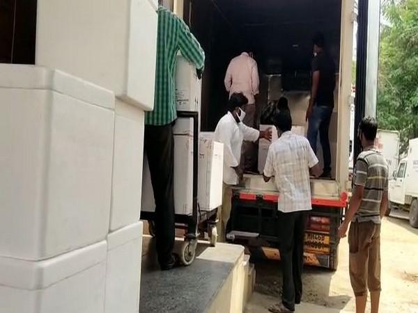 Transporting Covishield vaccine doses to state storage centre at Gannavaram