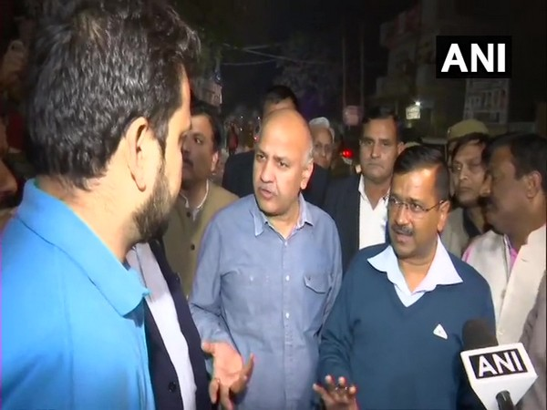 Chief Minister Arvind Kejriwal and his deputy Manish Sisodia speaking to locals in North-East Delhi on Wednesday. Photo/ANI