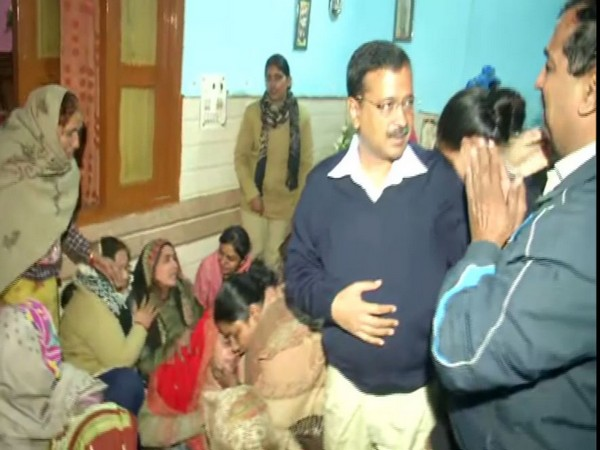 CM Arvind Kejriwal meets family members of firefighter died in Peeragarhi blaze. Phoot/ANI