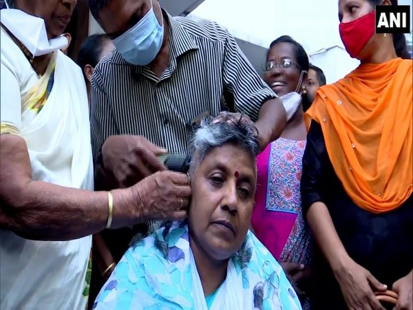 Congress leader Lathika Subhash gets her head tonsured after being denied the party ticket for Assembly elections. (Photo/ ANI)